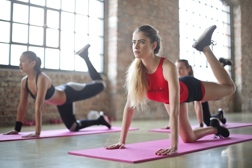 A group of women take a yoga class to lose weight and improve their core strength