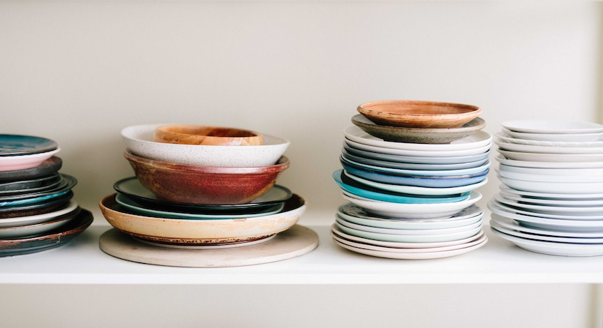 A shelf of empty dishes represents not eating while fasting